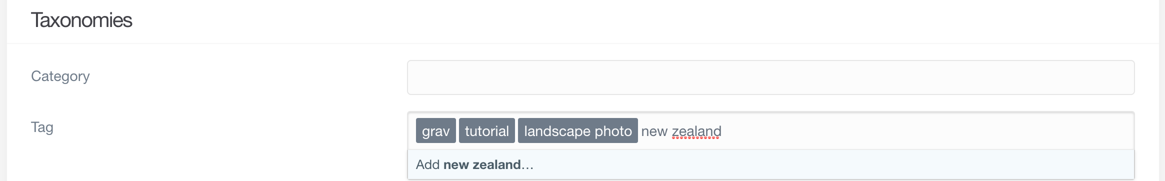The tags 'grav' 'tutorial' and 'landscape photo' have been added. 'new zealand' has been typed into the box but not yet added.
